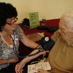 Home Care monitors blood pressure at Wellness Fair